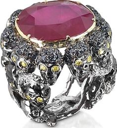 Polished 9 karat gold 2610 gr Skulls and Snakes ring with an oval cut glass treated ruby 1792 ct in a cabochon setting. 120 black diamonds 118 ct encrust 10 sculls while 20 yellow diamonds 058 ct make their eyes shine with an ethereal brilliance. #BernardDelettrez #Black,Yellow,Red #Rings #Forzieri #Women #fashion #obsessory #fashion #lifestyle #style #myobsession #stylish #luxury #luxuryfashion #jewellery #accessories #dresstoimpress