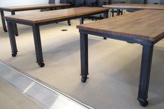 Conference tables. Maple butcherblock, treated with iron and vinegar. Blackened steel bases. - NKBuild
