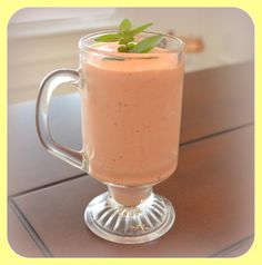 Metabolic Blend Fruit Smoothie to manage hunger and promote weight loss naturally. RECIPE: flesh of 1 mango, 1 regular/small size container of lemon yogurt (your favorite kind), 1/4 to 1/2 cup of your favorite milk, handful of frozen strawberries, 4 drops of doTerra Slim Sassy Metabolic Blend. Garnish with some fresh Chocolate Mint (optional). http://www.mydoterra.com/essentialoilsthatrock