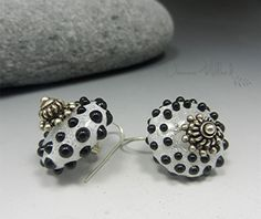 Like snow on a winters day...  ARTIST GLASS EARRINGS  These earrings feature a pair of handmade glass lampwork beads made by me, Donna Millard. Ive fashioned them with hand forged sterling silver french hooks and ear nuts keep them in place. These are actually very lightweight.  Glass measurement across - appx. 17mm The glass beads are clear with white enamels over the top with rows and rows of black surface dots for decoration. These are fun, everyone that comes into my gallery loves them…