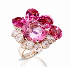 ( Palmellatto) Ring in 18k natural white gold composed of a 13.93 carat cushion faceted pink tourmaline with pink tourmaline drops and rose cut diamonds.