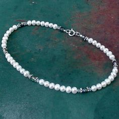 Multicolored crystals glitter when paired with white luminous pearls and enhanced by silver. This anklet is perfect for the pearl girl in you! 30th Anniversary Gifts, Anklet, Pearl White, Pearl Necklace, Glitter, Pearls, Crystals, Simple, Silver