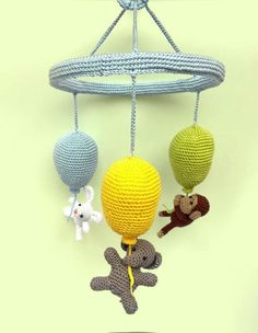 This wonderful crib mobile is perfect for your baby's nursery! It features 3 colorful crocheted balloons and 3 cute animals who will catch your baby's attention.This balloon mobile is totally handmade using 100% cotton yarn, fiberfill stuffing and a wooden frame.The 3 little animals hanging from the balloons are a monkey, a bunny and an elephant.The mobile measures 20 cm - 7.80 inches (width), and 30 cm - 11.80 inches (height) The balloons' colors are light blue, yellow and apple ...