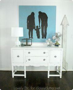 DIY family silhouette artwork tutorial - www.classyclutter.net. I would love to hang something like this in the master bedroom.