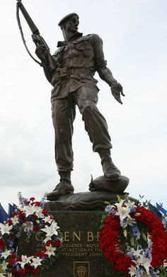 Bronze Bruce, the Special Forces memorial statue outside the USASOC Headquarters building at Fort Bragg, N.C., overlooks the U.S. flag