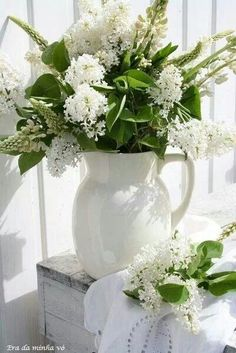 white flowers in a large white pitcher - dreams for the new world - picking your own white lilacs out of the garden and letting their smell fill the inside of your home!