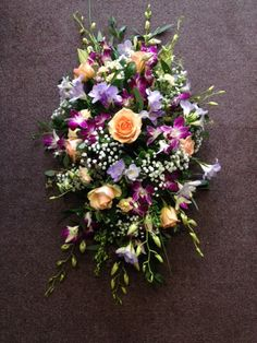 Classics design with orchids special roses and scented freesias  my favourite funeral price  petite fleur florist Benfleet