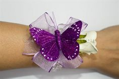 Purple And Ivory Butterfly Wrist Corsage for weddings and proms. Designed with a beautiful ivory rose, lilac organza and purple feather butterfly. #wristcorsage #promcorsage £22