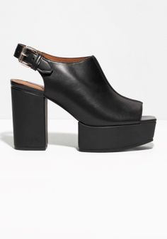 & OTHER STORIES Elevating statement leather shoes with a robust welt and heel that create an updated platform and add a defining edge to anything you wear above. Heeled Sandals, Black Sandals, Heeled Mules, Sandals Platform, Ss15 Fashion, Fashion Story, Minimal Fashion, Shoe Shop, Chunky Heels