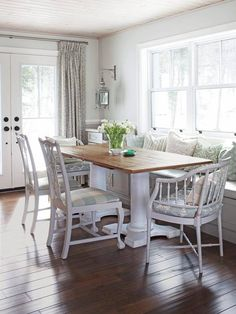 Love a lot of things about this-the wall color and also how great the white looks with the oak table legs and darker wood floors.  Blends very well together