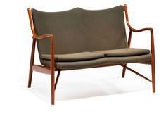 "Finn Juhl: ""FJ 45"". Freestanding two seater teak sofa. Seat, back and loose cushion upholstered with green wool."
