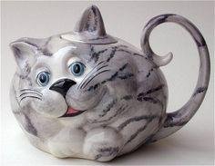 tetera-gato                                                                                                                                                                                 Más