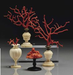 VASE IVORY RUNNING GERMANY XVIITH CENTURY Decorated with a sprig of coral PAIR OF CORAL ON BASES IN IVORY TURNING XVIITH CENTURY AND MORE LATE ELEMENT IN CORAL CARVED REPRESENTING THE REMOVAL OF EUROPE NAPLES, eighteenth century Based on a wooden base turned a later period