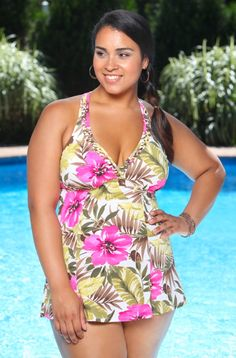 The Fiji Floral H-Back Plus Size Swim Dress Style #9124W by It Figures, is an all around, absolutely beautiful plus size bathing suit.  The print is green and taupe colored leaves and pink hibiscus l