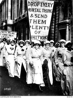 WWI: English recruiting campaign for munition factories. Women munition workers wearing gas-masks. - AWM