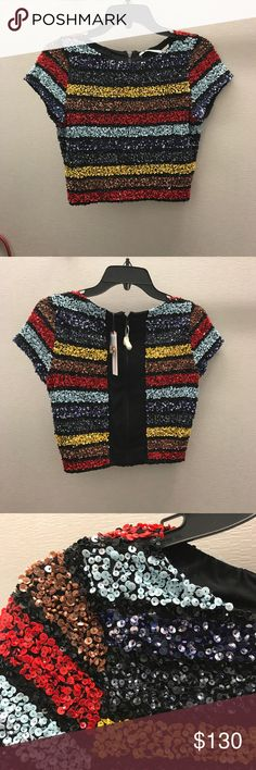 """Alice and Olivia """"Kelli"""" sequin stripe crop top New with Tags. Gorgeous multi colored striped Alice and Olivia crop top. Stretch lining and super comfortable. Brand new with tags but may have a few loose threads hanging that can easily be clipped. Alice & Olivia Tops Crop Tops"""