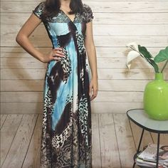Leopard Maxi Dress Long and comfy dress. Stretchy material. Elastic waist. I am 5'3 and a size 2. Length from the waist down is approx 37in. This item is available. Don't forget to check out my Deal of the Month listing ! Dresses Maxi