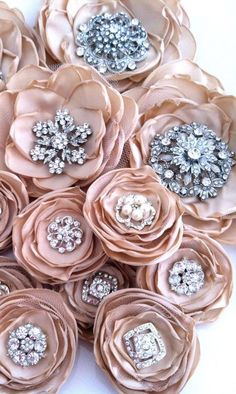 Rose brooches (add a rhinestone pin center to flattened silk florals)...