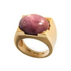 Jona design collection, hand crafted in Italy, star ruby 18 Karat yellow gold ring, featuring a natural oval-shaped cabochon star ruby weighing 24 carats; size 7.