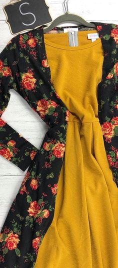 Floral LulaRoe Sarah with a mustard-gold LulaRoe Amelia. Looking for that perfect LulaRoe outfit? Would you rather shop in the comfort of your own home, in your pajamas? Then visit our VIP shopping group here! www.bobbiesdreamers.com Carly · Sarah · Jill · Joy · Amelia · Lindsay · Shirley · Lynnae · Cassie · Madison · Julia · Randy · Lucy · Disney · Azure ·Nicole · Maxi · Lola · Irma · Classic T · Perfect T · Gigi