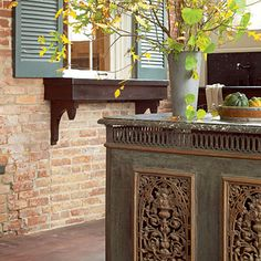 This would also make a great outdoor bar    Outdoor Kitchen.  The island is made from an antique radiator cover pained and topped with granite.  Southern Living