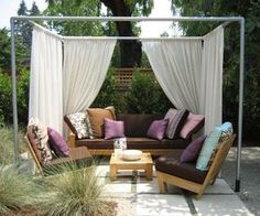 This simple and ingenious outdoor room (also designed by Whiteley) uses a frame of pvc pipe set into pvc sleeves pounded into the ground to define a sitting area. The curtain fabric is weather-resistant Sunbrella fabric.