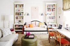 Green and orange living room with big bookshelf