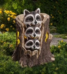 Three sweet raccoons are peeking out from the safety of their cozy home in a stump, showing off their adorable bandit-like markings. By day, a discreet solar panel captures the energy of the sun to power a warm LED glow from within the stump after dark. Guaranteed not to ransack your garbage cans, these delightful raccoons just want to share their love. Cast in weather-resistant resin for year-round outdoor display. #garden #patio #raccoon #cute