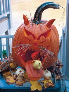 http://www.pinterest.com/furbacher/pumpkin-carving-creations/  Cat Pumpkin!