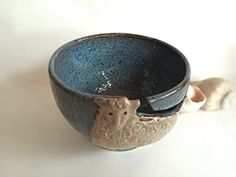Sheep Lamb Yarn Bowl ~ Stone Denim Blue ~for Knitting & Crochet ~ Handmade Pottery Free Shipping #handmade Handcrafted Pottery Bowl for knitting, crochet, yarn or string of any sort. It has high walls and angled rim to keep yarn from rolling around the floor and away from playful pets. A great gift for Knitters to help keep the ball of yarn nestled in the deep roomy bowl. Each one may vary from the pictures. The glaze can vary from a sky blue to a plum and it is brown on the texture ..