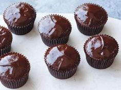 Chocolate Ganache Cupcakes : Ina Garten tops chocolate cupcakes with a ganache made from heavy cream, chocolate chips and instant coffee.