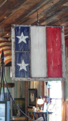 Repurposed 100 year old window frame.  No glass and missing panes.  Utilized remained space to incorporate stars and stripes.