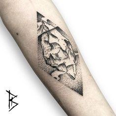 Engraving/dotwork style iceberg tattoo on the left forearm.