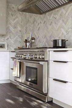 Chevron tiles in pale grey.