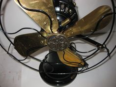"""1905 GE coin-operated fan with 12"""" brass blades (Type 272036-1). You insert a nickel and turn the knob for an hour of operation. Insert additional nickels for more time. (see close-up)"""