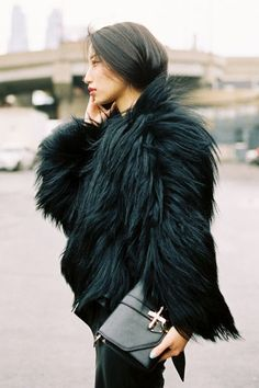 We're currently on the hunt for chic, warm winter coats for the coming season. Love this fur jacket and Givenchy clutch.