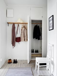 Minimalistic and organized hallway/entry room with a simple hat rack and built in-storage. Gothenburg apartment in Sweden (Scandinavia).