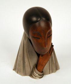 Hagenauer - Beautiful Wood & Metal Sculpture of A Woman http://www.valerioartdeco.com/hagenauer+wood+and+metal+womans+face+c5027/