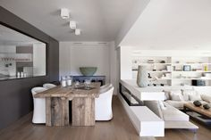 love the mixture of white and modern with old wood