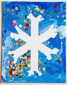 Kids winter snowflake craft: Just put painters tape on a canvas in the shape of a snowflake, use lots of different shades of blue paint and some white paint, let the munchkin paint away, add glitter or sparkles if you want, let dry half way, then peel off the tape.  Easy peasy!