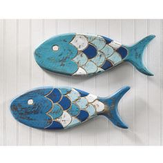 "Wooden Fish Plaques Set of Two - $29 This set of primitive-style folk art fish adds an exotic & aquatic touch to your décor. Handcrafted in Bali of natural weathered wood, this charming duo is painted in seaworthy shades of blue and white. Ready to hang. 5"" x 14 ½""."