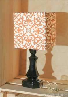 This square shade is just the thing for tiny spaces—and it only takes a little fabric to make it shine. We chose a smart orange print perfectly paired with a solid black lamp base.