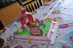 Prison City Cakes: Using Bakery Kits on Cakes. My Little Pony cake kit with added Pinkie Pie and Spike characters. Cake kit includes barn, Twilight Sparkle, and Apple Jack. The borders are decorated with cupcake rings.