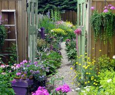 Most people think of their garden as a whole, but create vignettes. Here, for example, gates frame a view of the lushly planted backyard, inviting a closer look.