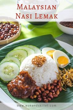 A quintessential Malaysian favorite. Nasi Lemak features fragrant and rich coconut rice with spicy sambal, topped with crispy anchovies, crunchy peanuts, hard-boiled egg, and cool cucumber. Boiled Egg, Hard Boiled, Seafood Recipes, Dinner Recipes, Dinner Ideas, Malaysian Food, Malaysian Recipes, Nasi Lemak, Coconut Rice