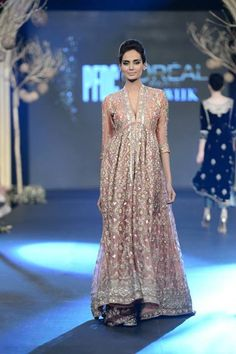 "This gorgeous Deena Rahman bridal dress was part of her collection titled ""Old World memories for other Inherited Objects."" The heavily embellished peach dress with long sleeves certainly brings a vintage feel to the designer dress."