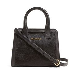 7572a68407 The calf hair accents on this bag make it stylishly on trend. This  crossbody features