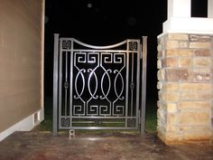 Geometric Gate--custom wrought iron gate that will fit in with just about any style garden. Love the simplicity. At the Show in 2009.