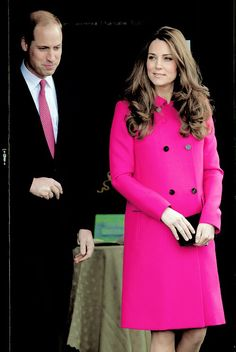 Almost like a prom couple, his tie coordinates with her bright pink coat.