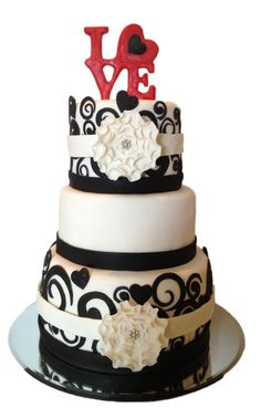 """Love"" black/white bridale shower cake with topper. Topper and flowers made with gumpaste. Swirls made from fondant. Cake is covered in fondant. This cake design is based on one I found by KarolynAndrea."